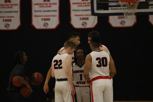 Members of the American River College men's basketball team huddle up during the game against San Joaquin Delta College on February 11, 2020. The team is now working out on their own, after practices and games have been canceled due to the coronavirus pandemic. (Photo by Heather Amberson)