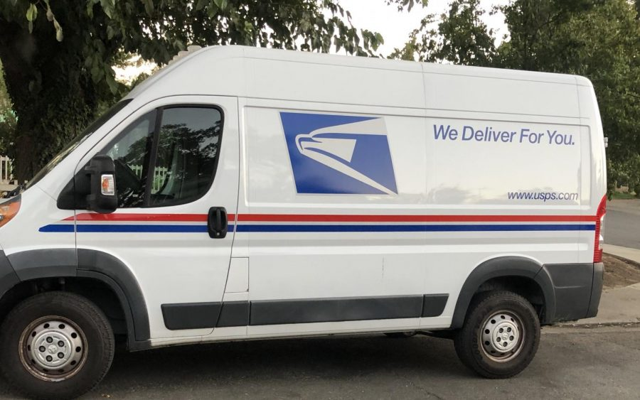 "A USPS van is parked in Sacramento, CA with the words written ""We deliver for you"" on its side on Tuesday, October 20, 2020. The federal agency has come under attack with budget cuts by the Trump administration, politically aimed to stop mail-in voting. The agency is currently facing an influx of mail-in voting because of COVID-19. This is as Americans and congress are working to save the struggling agency. (Photo by Irvis Orozco)"