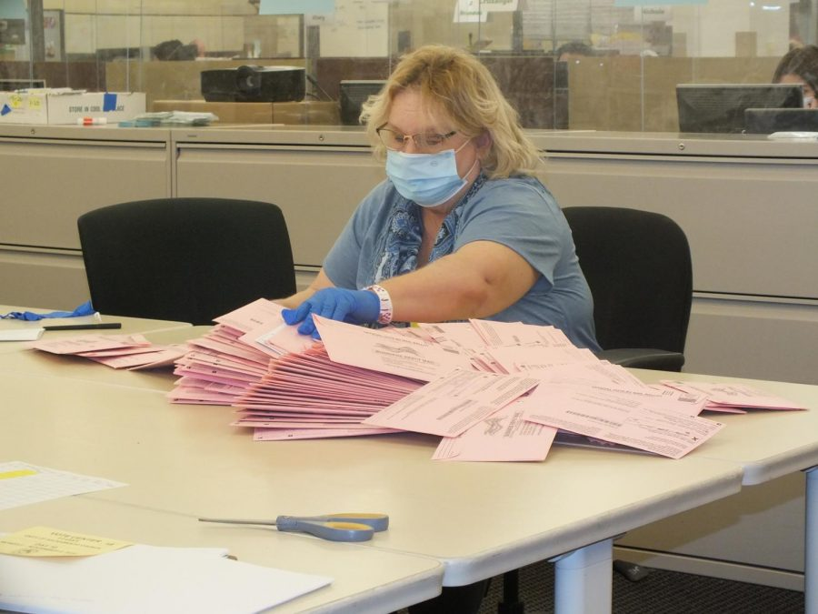 A ballot worker in Sacramento, California goes through hundreds of ballots received by the County Registers office on , Election Day, Tuesday Nov. 3, 2020. (Photo by Irvis Orozco)