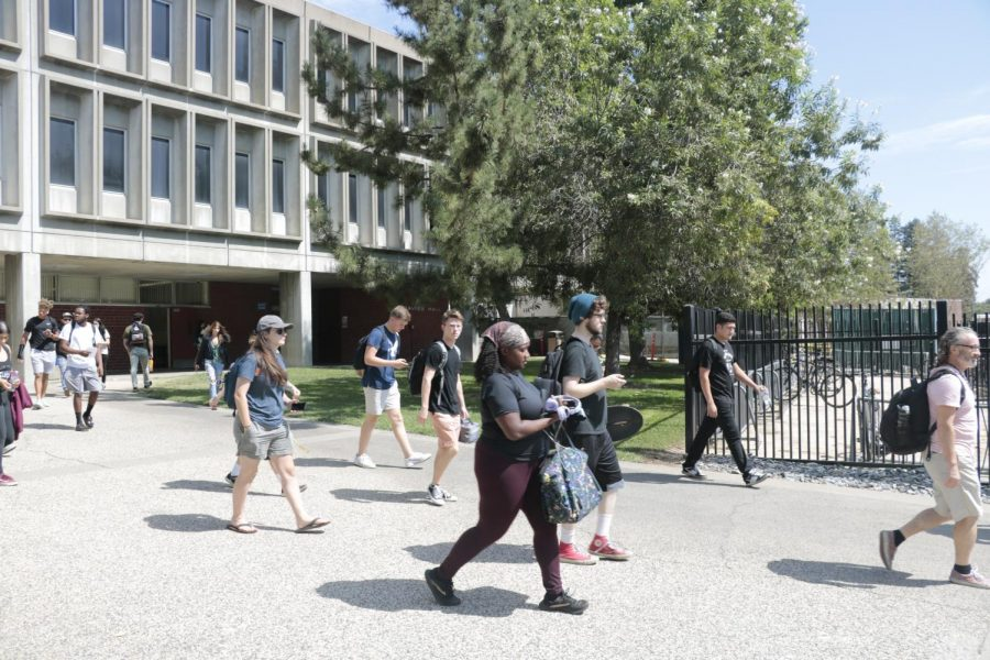 Students travel to classes between Davies Hall and the portable village on Sept. 5, 2019. There is a chance that there can be a return to campus for the fall 2021 semester. Student and faculty listening sessions and reopening reports are among the steps that will determine a possible reopening. (File Photo)
