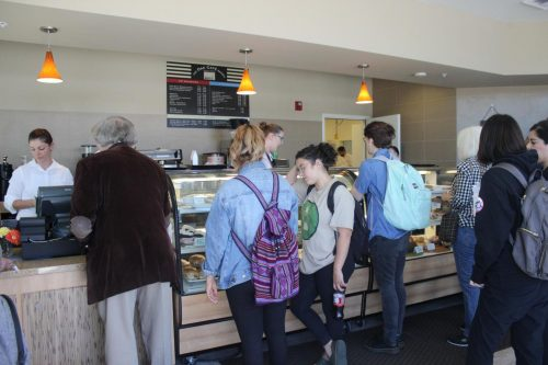 "Students wait in line at the Oak Cafe bakery on opening day on September 19, 2019. American River College hopes to bring back a series of ""impossible to convert classes,"" including the hospitality laboratory courses in which students operate the cafe, for the fall 2021 semester. (File Photo)"