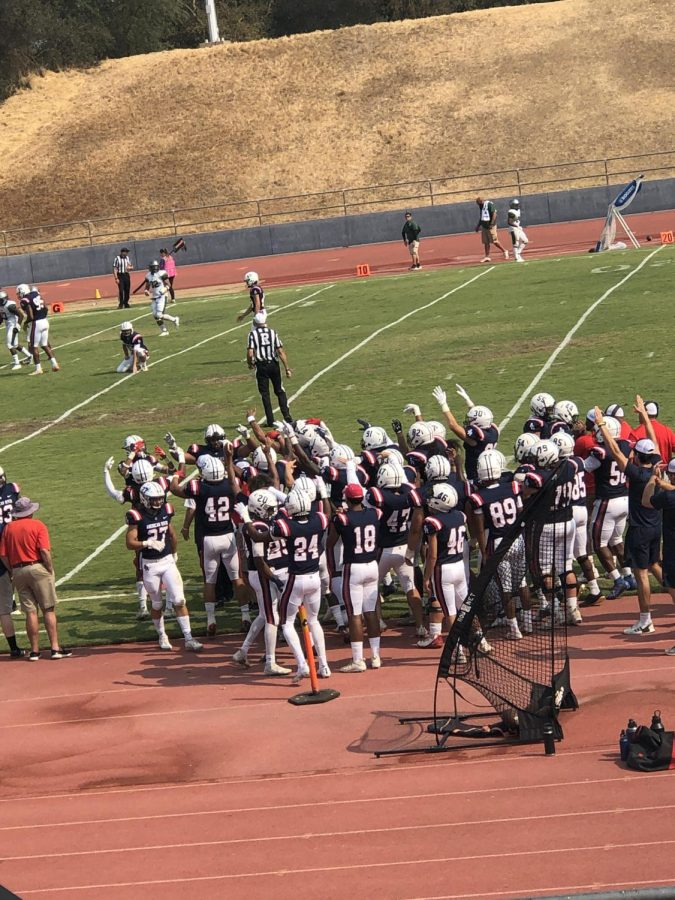 The American River College football team cheers on its players, though the team sustained a 16-30 loss versus Laney college on Oct. 2, 2021. (Photo by Cynsere Kelly)
