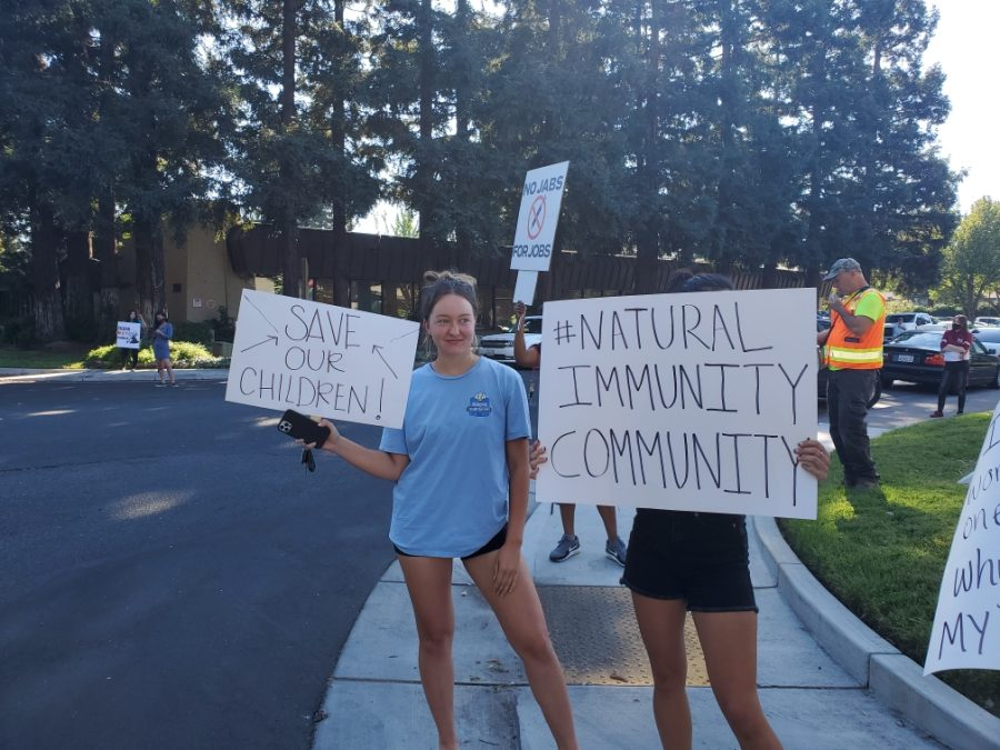 Emily Cowan, an American River College language studies major and tennis player protests, among other students, against the Los Rios Community College District COVID-19 vaccine mandate on Sept. 30, 2021. (Photo by Lorraine Barron)